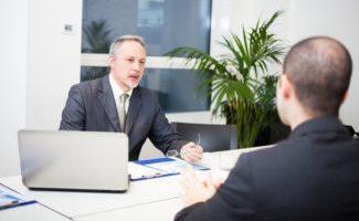 Manager explaining the international banking definition